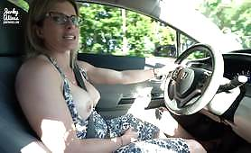 Driving out with her tits out