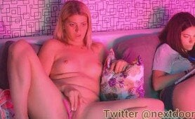 Blonde whore uses her Lovense Lush while sitting on the same couch with her girlfriend